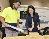 Deputy Premier Liza Harvey tries out her bricklaying skills